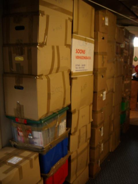 all our small boxes stacked up against the wall of the utility room
