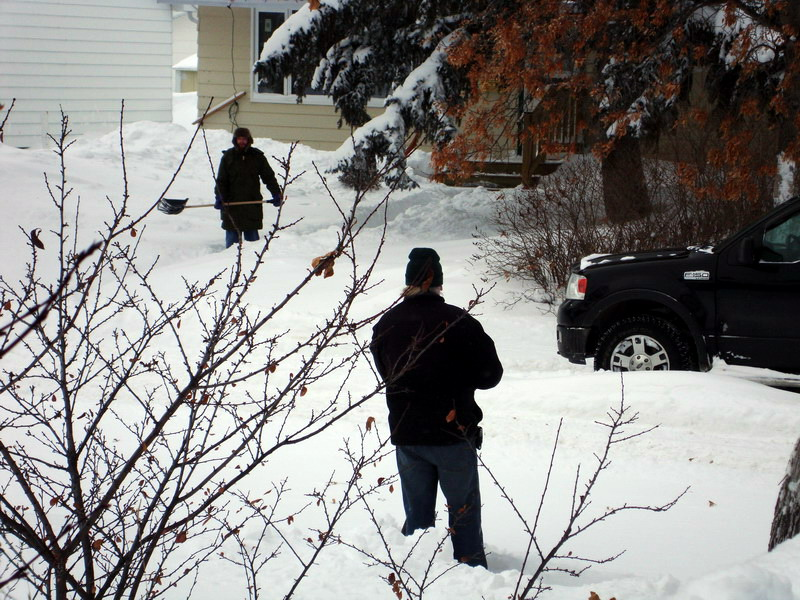 Randy and Nico shoveling snow