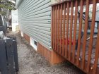 the siding for the skirting matches the cedar colour deck
